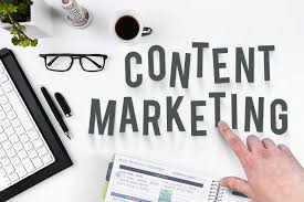 Hand spelling out 'Content Marketing' on a white desk